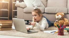 shocked little casual girl watching movie netflix viewing History ss FEATURED